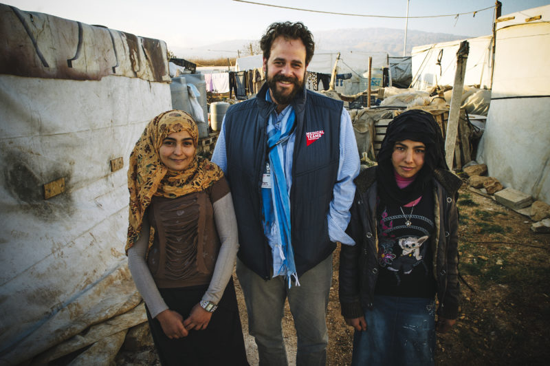 Roger Sandberg, vice president of International Field Operations, in Lebanon with Syrian refugees Kareena, left, and her sister Afaf