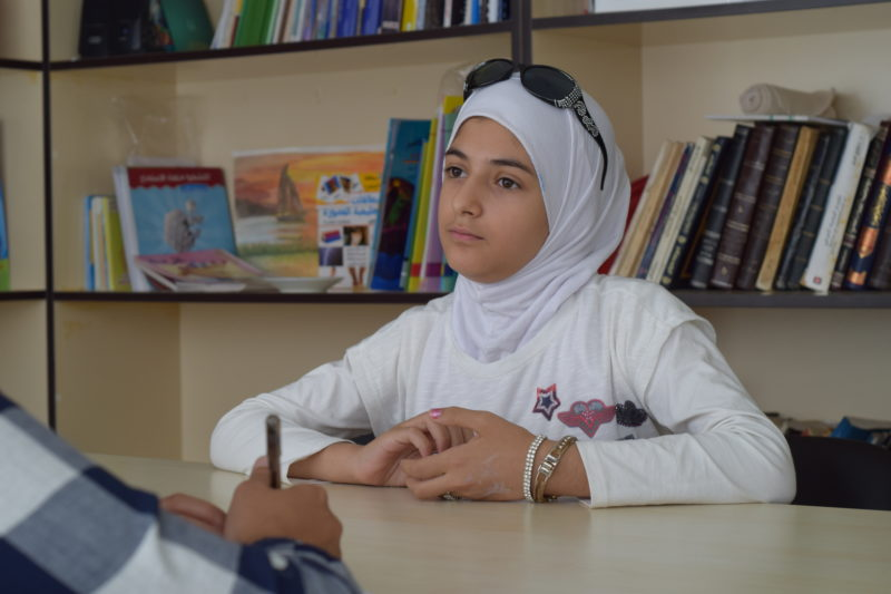 Aliaa, a Syrian girl who now lives in Turkey, sitting with a psychiatrist to work through psychological trauma
