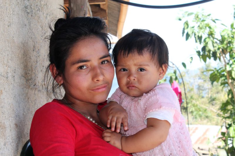 Marta, a woman in Guatemala who received Mother Counseling, holding her healthy baby