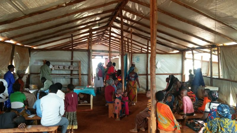 A health clinic in Nyarugusu Camp filled with people in need of medical care