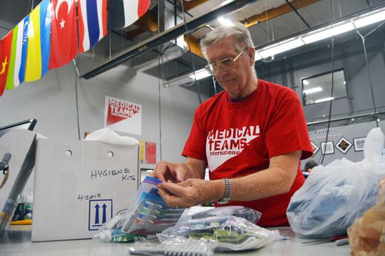 A faithful volunteers pack Hygiene Kits after Hurricane Harvey