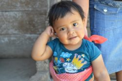 A Guatemalan baby, Eric, smiling into the camera
