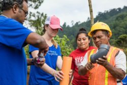 Volunteers from Providence St. Joseph Health and Medical Teams International staff construct clean water systems in rural Guatemala