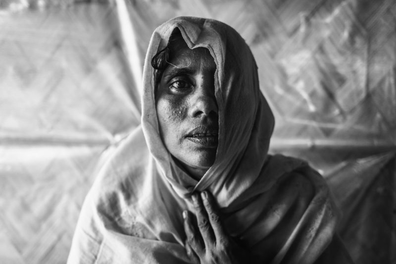 Nosima, a Rohingya refugee woman, sitting in a medical team's clinic