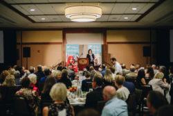 Melissa Fleming, head spokesperson for the UN Refugee Agency, speaks at Portland's Healthy Women, Healthy World luncheon