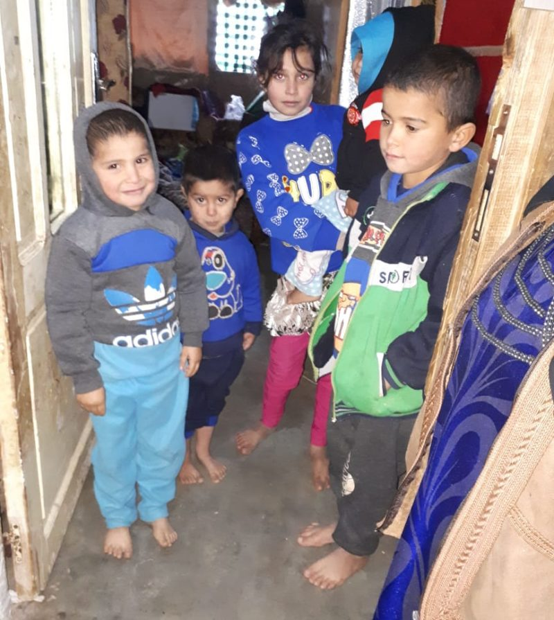 Syrian refugees' children huddled in their room during Storm Norma