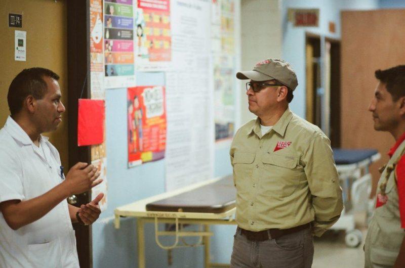 Director of Nursing, Profirio Aguliar, talks to a Medical Team staff at Uspantán National Hospital