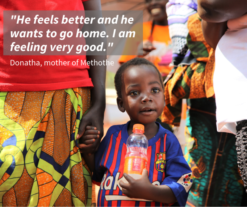 •Methothe, a refugee boy, holding hands with his mother after receiving life-saving medical care for his malaria