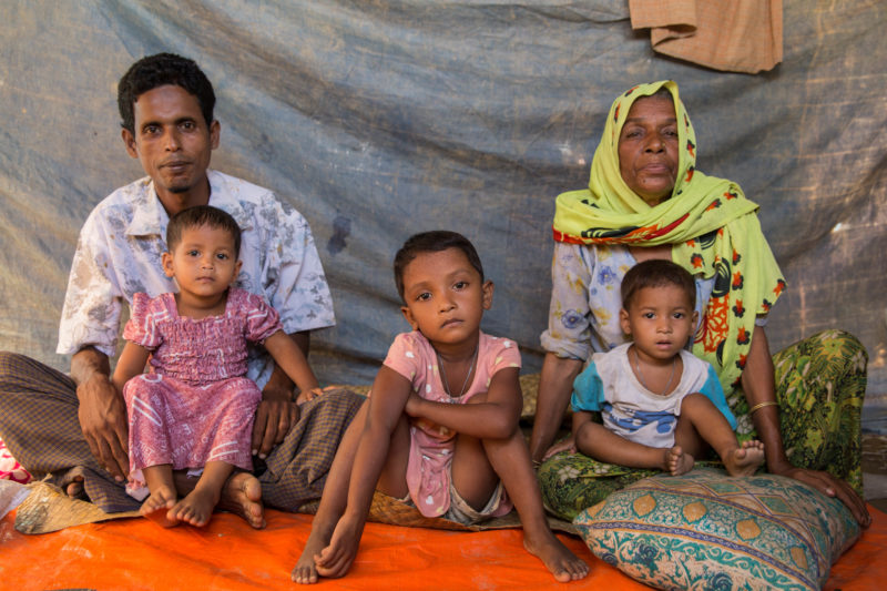 •Syrian refugee family sitting inside their tent in a refugee camp in Bangladesh