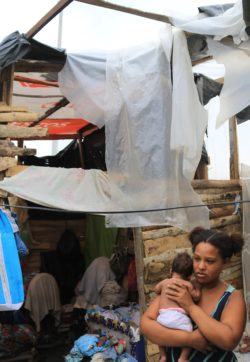 Stefanie and her child outside of their home in Colombia