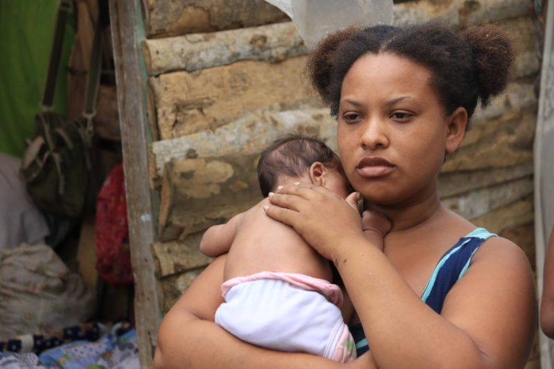 Stephanie, a new mother, living in the dumps outside of Colombia after leaving Venezuela