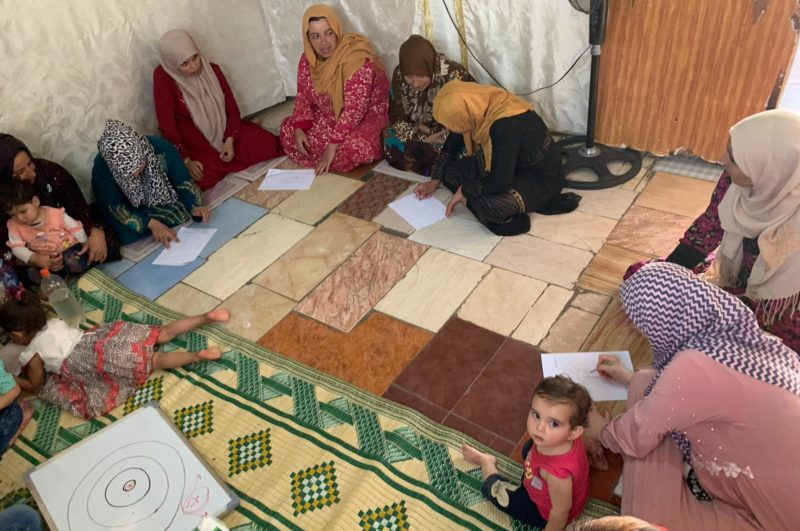 A group of Syrian refugee mothers meet in a support group in Lebanon, 2019.