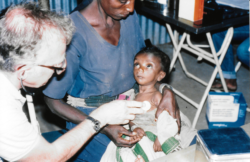 Historical photo, Ethiopian child and Dr. Cravens