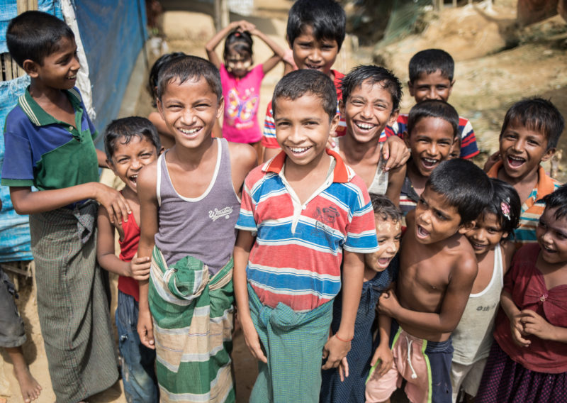 Harun, a Rohingya Refugee in the Kutupalong Refugee Camp, smiling with his friends