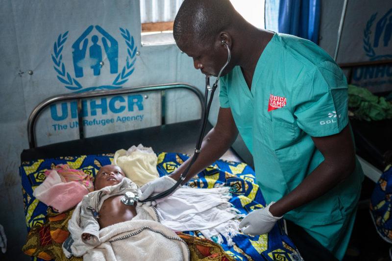 Uganda, treating a baby - Kyangwali, 2019.