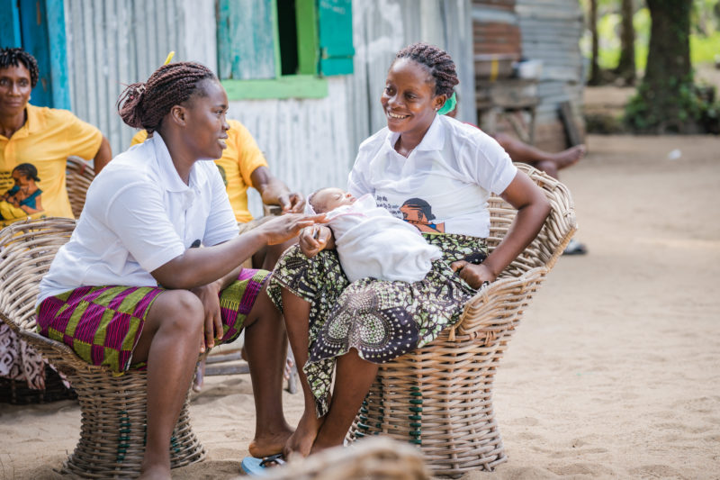Evalyn, one of the mother counselors, talks with Abigail about the maternal health