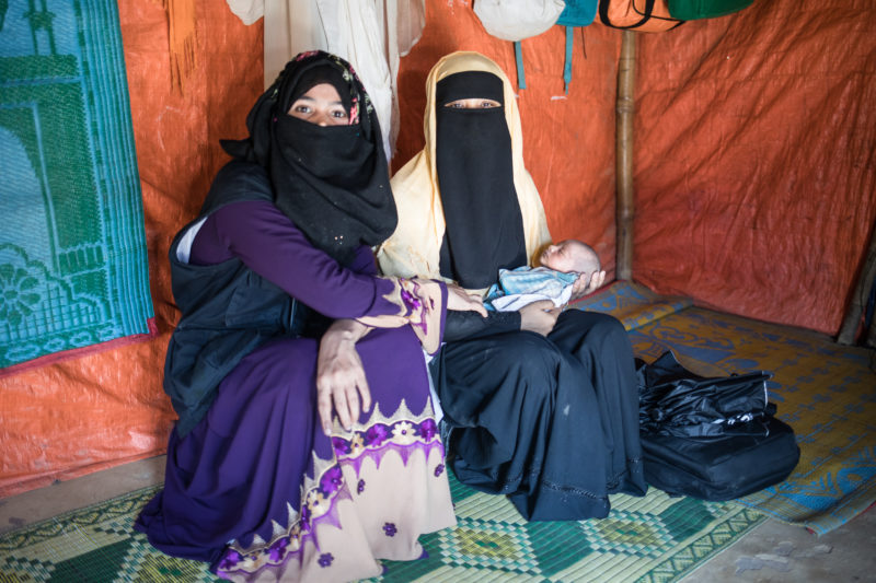 Community Health Worker Taslima, visiting a new mother in the Rutupalong Refugee Camp in Bangladesh