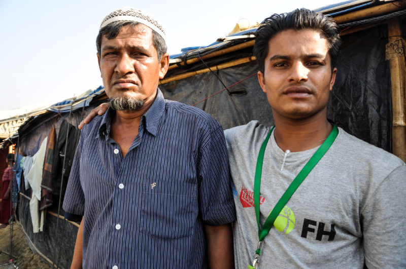 Redwan, a Bangladesh Rohingya refugee, posing with his father after escaping attack