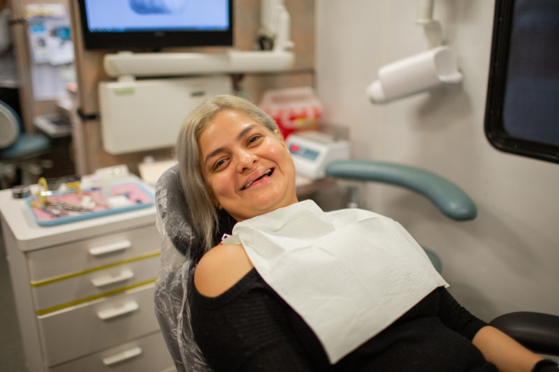 Jenny, sitting in the patient chair in the Mobile Dental van waiting for her filling procedure