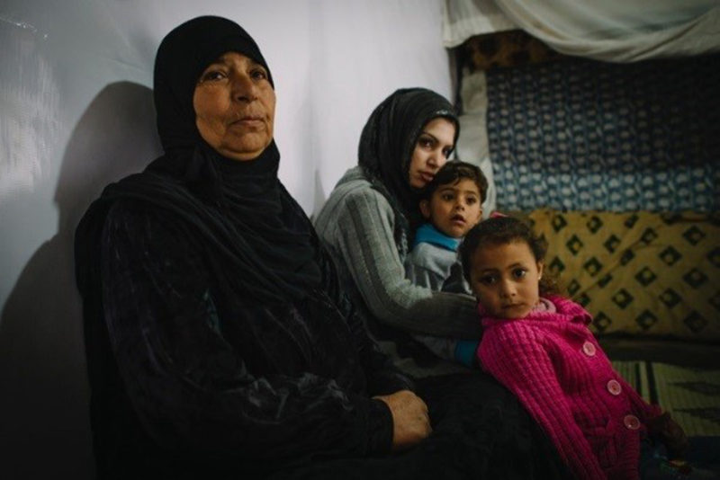 syrian refugee, Noura, with her family in their home