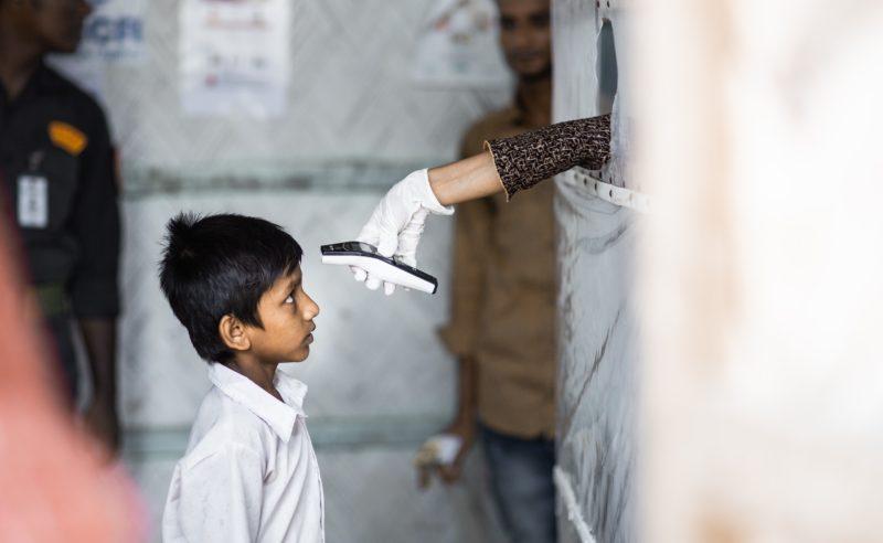 Bangladesh, boy getting temperature taken