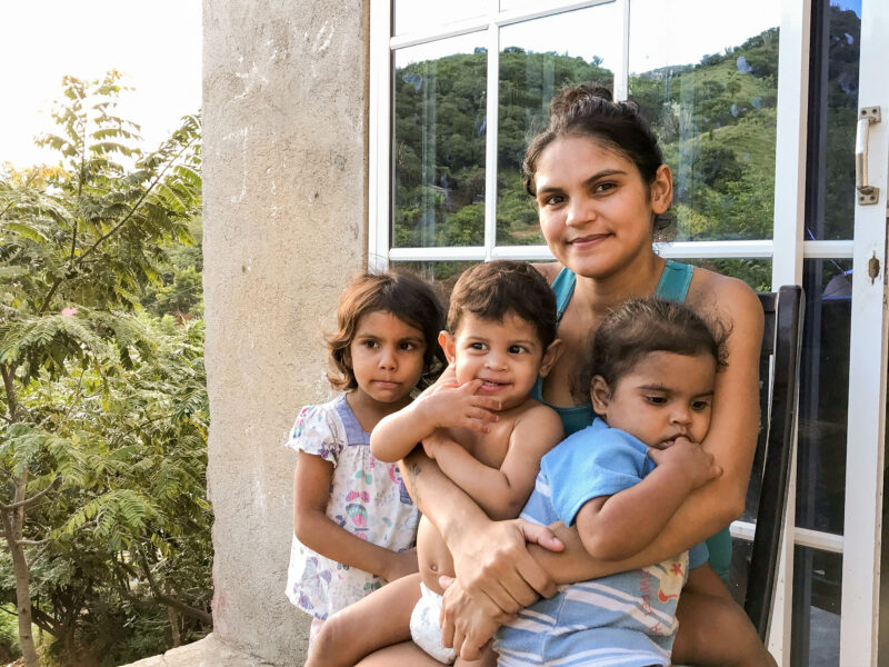 In Santa Marta, Colombia, Daimerlyn sits with her three children.