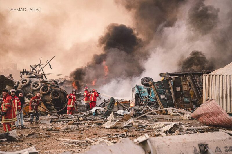 A team of firefighters standing in the rubble of damaged buildings after the massive chemical explosion in Beirut, Lebanon.