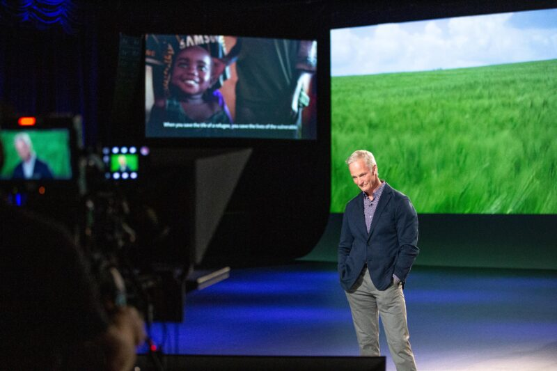 Presenter John Curley standing alone on the set of the virtual FIeld of Dreams event experience.