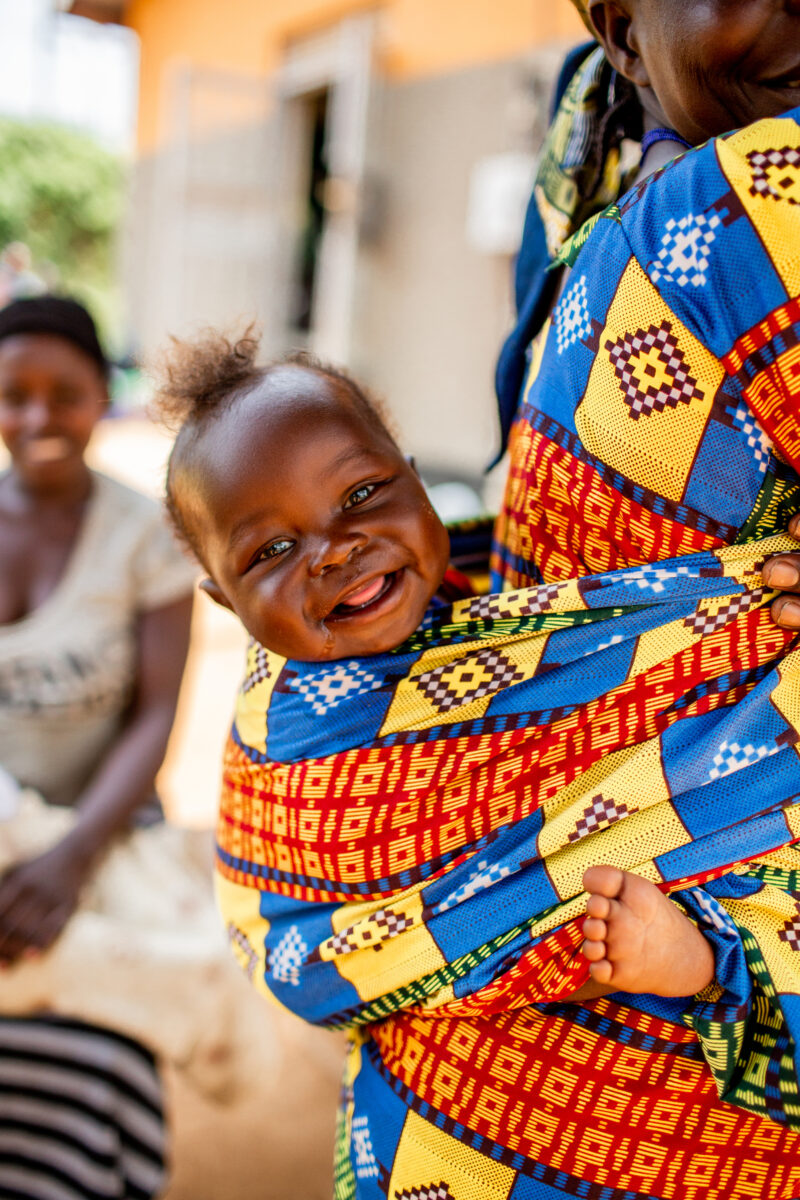 A happy baby smiling at the camera in Kyangwali Uganda.