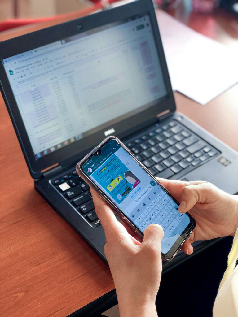 Photo of person on smart phone texting via WhatsApp