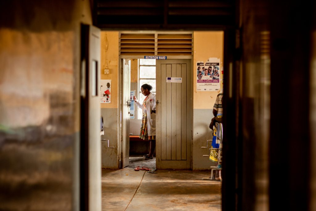 Monicah in the doorway of the nutrition ward in a medical clinic, Uganda.