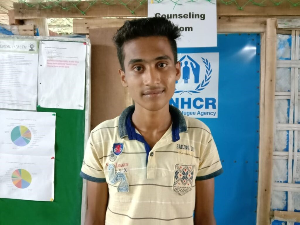 Hepzoor smiling at one of his final group counseling sessions in Bangladesh.