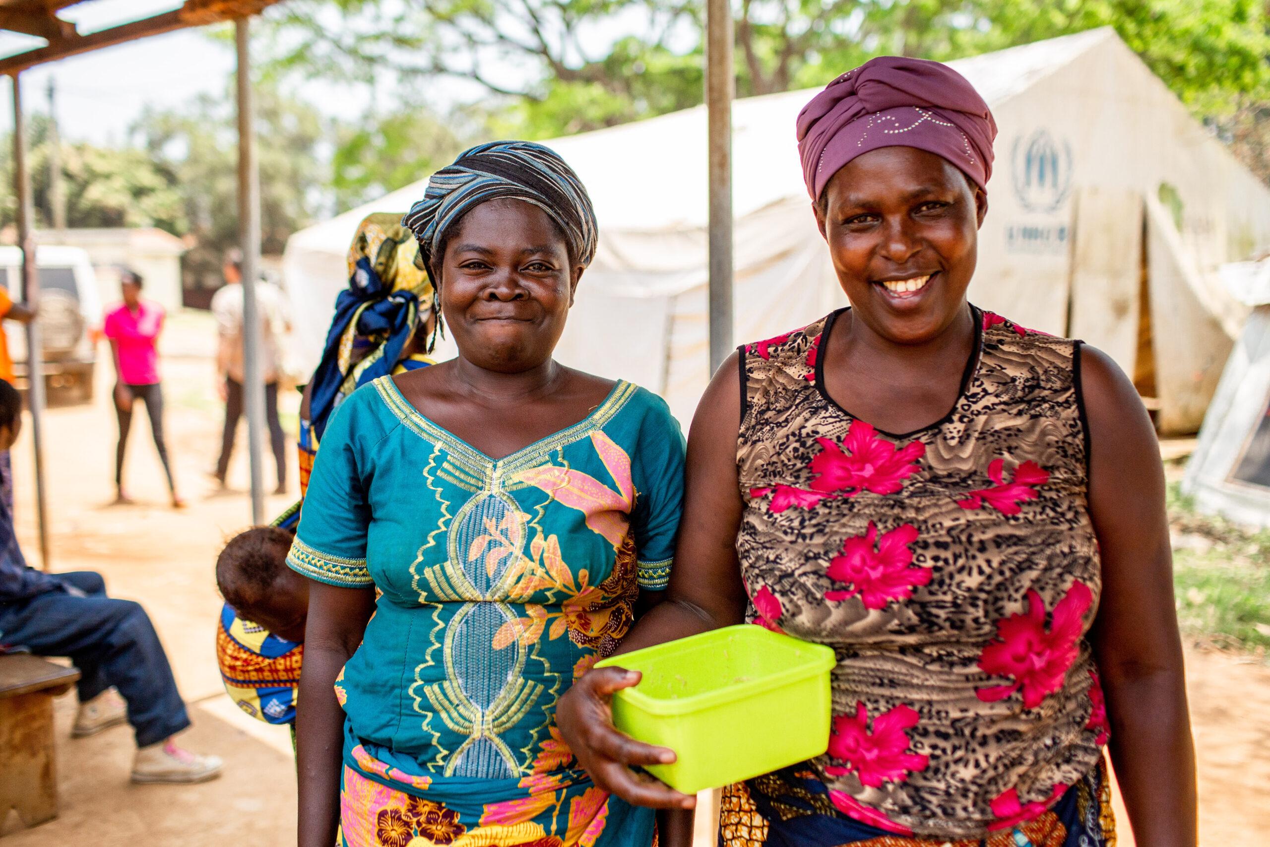Women waiting outside the maternal and child health ward in Kyangwali, Uganda
