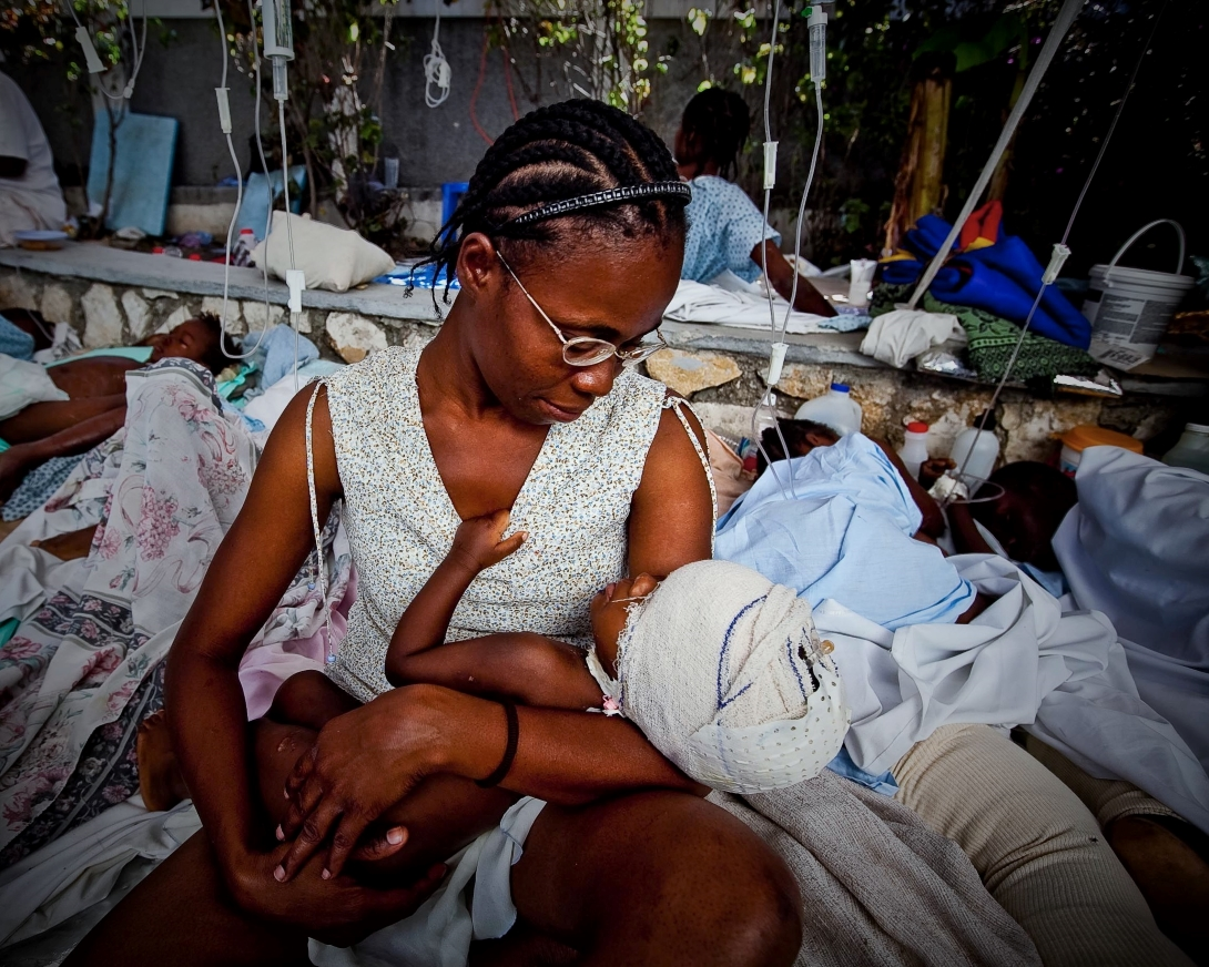 A mother and baby receive medical care after the earthquake in Haiti 2010